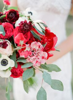red bouquets - photo by Sophie Epton Photography http://ruffledblog.com/modern-romantic-wedding-with-boho-details