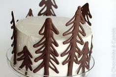 Make your own chocolate cake toppers using melted chocolate. These trees are lovely, but you could also write out names or numbers.Recipe: Chocolate Raspberry Forest Cake at Chocolate & Carrots Chocolate Tree, Christmas Chocolate, Noel Christmas, Melting Chocolate, Chocolate Shapes, Chocolate Color, Chocolate Chocolate, Homemade Chocolate, Christmas Ideas