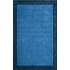 This is the rug we have in Patrick's room. Safavieh Handmade Himalayan Gabeh Bordered Blue Wool Rug 5x8 $121