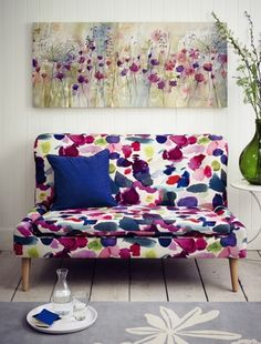 Why not upholster an old armchair or love seat in a striking print to make it the focus of the room? Living room ideas. John Lewis