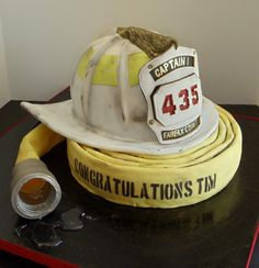 "I pinned this because of the melted sugar ""water"" detail.I like the little touches that make it look more realistic.I like this hose the best and the helmet had nice detail. Important question to ask Austen.does he like the taste of fondant? Crazy Cakes, Fancy Cakes, Unique Cakes, Creative Cakes, Fire Cake, Fire Fighter Cake, Retirement Cakes, Sculpted Cakes, Gateaux Cake"