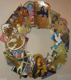 Wreath made from recycled cards - layer with small cardboard squares between each layer.  Use styrofoam base.