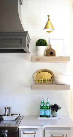 Kitchen Floating Shelves. Open shelving by kitchen hood are reclaimed floating…
