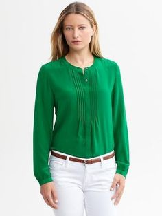 Banana Republic Silk pintuck blouse. Tucked into white skinny jeans.