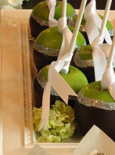 Chocolate apples with edible glitter & white satin ribbon. Fun idea for the dessert buffet!