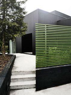 Villa Weinberg, Aarhus, Denmark, black wood clad exterior with green fence | Remodelista