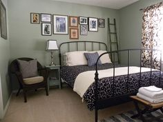 guest room - green walls, ikea iron bed, wicker and gallery wall