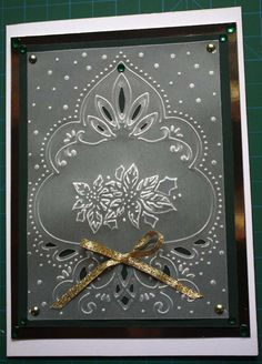 Paper Play by Kathi: Marianne Designs...embossed vellum overlay on top of dark green...very elegant look...