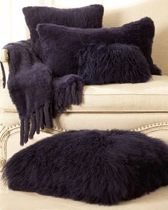 Love the deep purple! I especially like the one on the floor and the oblong one. Toss on a couch or bed.