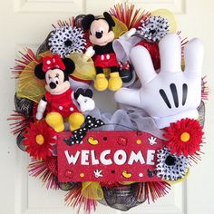 Ok, due to customer demand, I FINALLY have made an everyday Mickey Mouse Wreath! A wreath to hang between your holiday and seasonal wreaths. I am so happy with this wreath and apparently so are my customers!  This Mickey Mouse wreath is made with the four traditional colors of black, yellow, red and white. It features Mickey Mouse and Minnie Mouse, a white glove and a stunning Welcome sign with sparkles on it! This sign was made by the talented Erin, from diamonddustdesigns.etsy.com. I added…