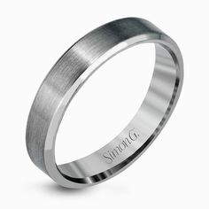 This simple but elegant men's wedding band in brushed platinum is highlighted by two smooth rims, resulting in a brilliant contemporary design. Print Page