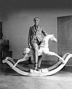 Max Ernst with rocking horse, Paris1938