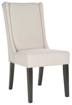 Outfit your dining room or kitchen in chic style with this eye-catching side chair, showcasing nailhead trim. Pair it with a traditional table for a pop of drama or set it in the living room for a convenient seat for guests.