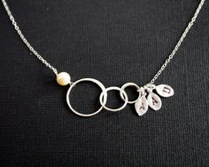 Eternity circle necklace with three initial leaves and by chiky, $37.50