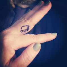 Peek a boo #fingertattoo #book #smalltattoo #booktattoo