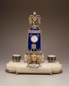 Regimental Desk Clock, Fabergé (firm); Rappoport, Julius (workmaster) RUSSIA: Moscow Ca. 1896 Silver gilt, enamel, marble.