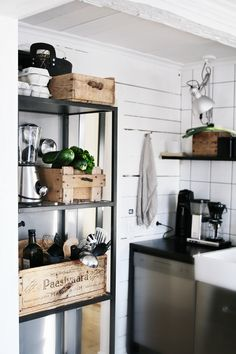 Wooden crate storage and white plank walls - what's not to love?
