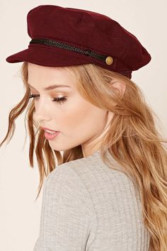 A cabby hat featuring a braided band with burnished accents. #accessorize