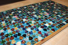 DIY Guitar Pick Table Top- click photo to view instructions.