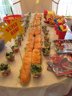 """Super Hero"" sandwiches and layered taco cups.  Fresh fruit in waffle cones.  Super Hero Baby Shower."