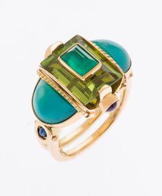 Ring in 22k, 18k, Columbian emerald, Burmese peridot, gem silica, sapphires, and amethyst. By Michael Boyd