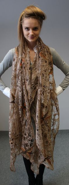 Romantic, soft, large, very light shawl . Handmade from silk and merino wool, with cobweb felt techniques. Cover shoulders on a special evening. Put on your neck on a cold day. Or you can use as a material piece of your apparel. ___________________________________ Size: Length 228 cm. Width 92 cm. color: brown