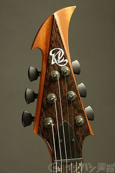 Kenneth Lawrence headstock