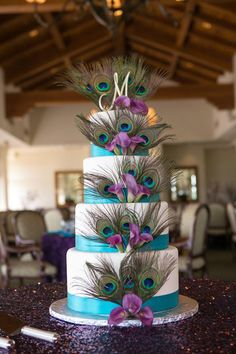peacock wedding cake with sparkley tablecloth