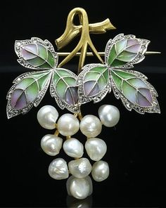 An Art Nouveau plique-à-jour enamel, gold and pearl pendant/brooch, probably Austrian, 1900-1910. Composed of natural pearls, rose diamonds, platinum and gold.
