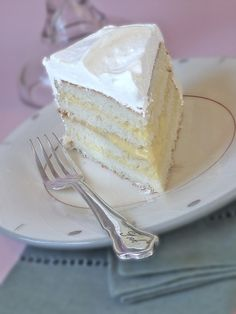 A slice of Coconut Cake with layers of Mango Curd