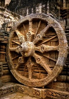 Konark Sun Temple Chariot Wheel, near Puri, India - one of 24 carved wheels of the huge chariot, built in the 13th century in the form of huge chariot of the Sun God with 24 wheels, 2 wheels in both sides, and 7 horses in front of the temple. The wheels represent the 12 months of a year and the horses, seven days of the week.