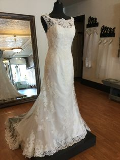 This lace off-the-shoulder fit and flair wedding dress has everything. With a scalloped train and beautifully beaded. Affordable Wedding Dresses, Wedding Dress Styles, Wedding Dress Boutiques, Off The Shoulder, Train, Bridal, Lace, Fit, Beauty