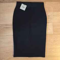 NWT ASOS Pencil Skirt Knee length, skin-hugging fit. Fits size 2 or 4. Scuba-like material (poly). 5% elastane, does have some stretch. Slit in middle back. No trades. ASOS Skirts Pencil