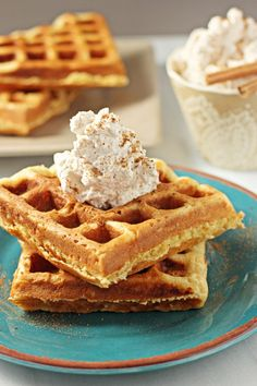 Recipe for eggnog waffles with cinnamon whipped cream. Crispy on the outside, chewy on the inside and with a hint of eggnog flavor to make them different.