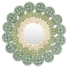 Add a boho-chic touch to your entryway or living room with this eye-catching medallion wall mirror, featuring wrought iron scrollwork in blue, green and ivor...