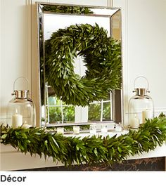 Love this whole look—esp the wreath hung on the mirror❣ The wreath & garland are great foundation pieces that can be changed each Christmas based on your style whims.