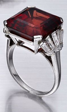 An art deco spinel and diamond ring, circa 1935 The square-cut spinel, weighing 18.70 carats, to fan-shaped shoulders set with baguette and single-cut diamonds, ring size L½
