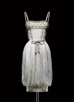 Yves Saint Laurent for Christian Dior, 1959  Armide tulle short evening dress with silver sequins. Audrey Hepburn immortalized this dress in a 1959 fashion shoot by Richard Avedon in Paris.