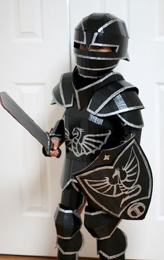 Black Knight Costume - Cardboard gothic armor for 6 year-old. Made with corrugated cardboard, hot glue, paint, some elastic bands and velcro.