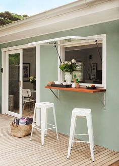 Simple shelving and awning window create a clever servery to…
