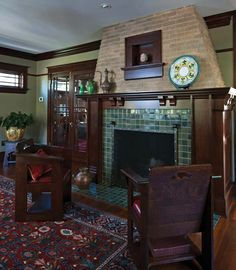 super love.  retro arts & crafts fireplace in a bungalow.  green tiles go so nice with the rich wood