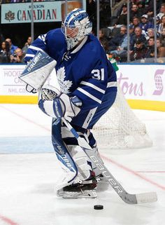 TORONTO ON - NOVEMBER Frederik Andersen of the Toronto Maple Leafs handles the puck against the Vancouver Canucks during the third period at the Air Canada Centre on November 5 2016 in Toronto Ontario Canada. (Photo by Kevin Sousa/NHLI via Getty Images) Hockey Goalie, Ice Hockey, Toronto Maple Leafs Wallpaper, Air Canada Centre, Maple Leafs Hockey, Toronto Ontario Canada, Goalie Mask, Nhl Games, Vancouver Canucks