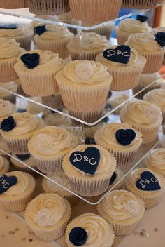 Navy and Ivory Wedding Cupcakes. So CUTE , might try to do maple leafs instead of hearts or a mix of both