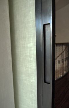 slim design sliding doors: blackened steel with removable glass stops