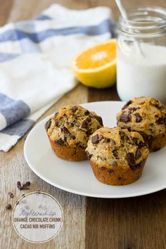 Moist & tender whole wheat muffins with a bright orange flavor, studded with chunks of dark chocolate and crunchy cacao nibs. | www.brighteyedbaker.com