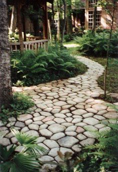 Two Men and a Little Farm: QUIKRETE COBBLESTONE PATH MOLD. This would be a great style from the back to the front of the house around the garden. And eventually from there to the bridge. This might be a great use for all of that sea glass I just got, too. Mixed in with the Quikrete it would be beautiful.