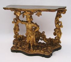 A Fine Venetian 18th Century Baroque Style Gild-Wood Figural Carved Console Side Table with a figure of a standing Putto amogst grape vines and leaves. Circa: Venice, 1780