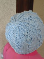 Ravelry: Softly Drifts the Snow Cabled Hat pattern by Lara Sue