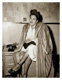 Billie Holiday had an amazing voice, I love listening to her music. This is a fabulous photograph of her.