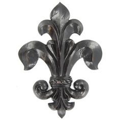 "This Fleur-De-Lis Wall Plaque is beautiful mounted on the wall alone or it can be coordinated with similar pieces to add a warmth and artful touch to any decor.    	The piece has a distressed black finish with red undertones.    	It measures 12 1/2"" wide x 17 1/2"" tall x 3/4"" thick and has built-in hanging hardware on the back of the plaque."